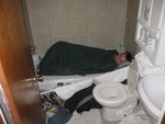 Guest crew Erik Hardy chooses the comfort of the womb-like bathtub as the venue to undertake his evening slumber